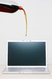Soda Pouring on Computer Stock Photo