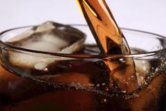 Soda Pouring Over Ice Stock Photo