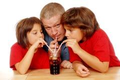 Soda sorseggiante tre Fotografia Stock Libera da Diritti