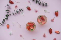 Soda with strawberries on a pink background. Summer refreshing d royalty free stock photo