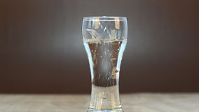 Soda water in glass stock video footage