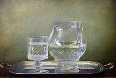 Soda water jug and glass on silver tray Stock Photos