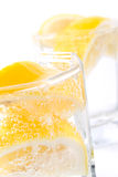 Soda water and lemon Stock Photos