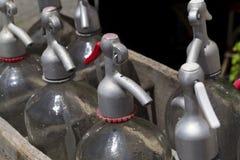 Soda water syphon bottles with metallic caps Stock Photo