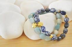 Sodalite and Amazonite gemstone bracelets with cross Stock Image