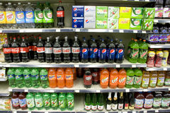 Sodas on store shelves. Different brands and flavors of soda for sale in a market Stock Photos
