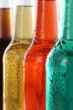 Sodavatten dricker med cola och öl i flaskor royaltyfri fotografi