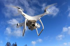 DJI Phantom 4 pro drone. Sodertalje, Sweden - February 4, 2018: One white DJI Phantom 4 Pro drone in flight royalty free stock images
