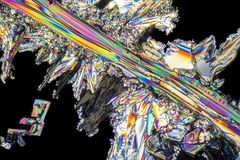 Sodium nitrate microcrystals. Colorful microscopic shot of Sodium nitrate microcrystals in polarized light Royalty Free Stock Image