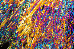 Sodium nitrate microcrystals. Colorful microscopic shot of Sodium nitrate microcrystals in polarized light Stock Images