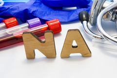 Sodium in serum or blood in basic metabolic test. Laboratory test tubes with blood, stethoscope, smear or film and gloves are near. Note with text serum sodium royalty free stock photo