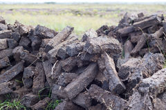 Sods of turf stacked up to dry Royalty Free Stock Photos