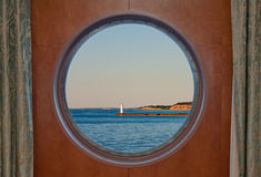 Sodus Bay Lighthouse on Lake Ontario seen through a Boat Porthol Royalty Free Stock Images