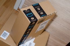 Soest, Germany - December 19, 2017: Amazon Prime logotype printed on cardboard box security scotch tape. Amazon Prime is a paid. Amazon Prime logotype printed on royalty free stock photography
