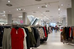 Soest, Germany - December 17, 2018: Buyers in H&M clothing store. H&M Hennes & Mauritz AB is a Swedish multinational clothing- stock photo