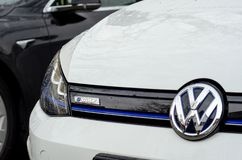Soest, Germany - December 23, 2017: Close-up - the front of the white Volkswagen e-Golf car with the company logo