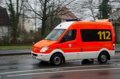 Soest, Germany - December 20, 2017: German ambulance service car drives on a street. 112 is the European emergency number that. German ambulance service car royalty free stock photo