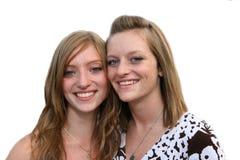 Soeurs de l'adolescence heureuses et meilleur franc Photos stock