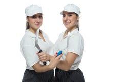 Soeurs jumelles de pizza sur le fond blanc Photographie stock libre de droits