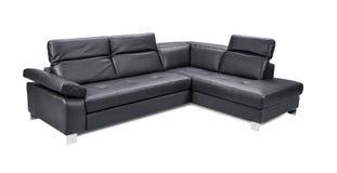 Sofà nero d'angolo di cuoio di lusso isolato su fondo bianco Fotografia Stock