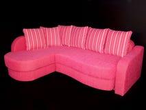 Sofà rosa Immagini Stock