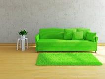 Sofà verde vicino alla parete Fotografia Stock Libera da Diritti