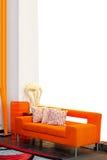 Sofá anaranjado imagen de archivo libre de regalías