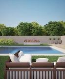 Sofá cerca de la piscina Imagenes de archivo