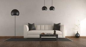 Sofá clásico en un cuarto blanco foto de archivo libre de regalías