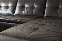 Sofá de couro preto Imagens de Stock