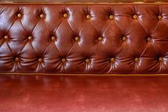 Sofá de couro vermelho Fotografia de Stock Royalty Free