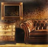 Sofá de cuero de Brown con el marco vacío Imagen de archivo libre de regalías