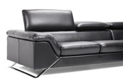 Sofá de cuero negro Fotografía de archivo libre de regalías