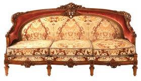Sofá de oro-rojo antiguo de madera árabe Fotografía de archivo
