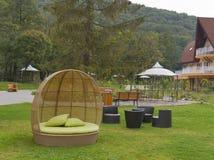 Sofá de vime do rattan moderno da mobília exterior Foto de Stock