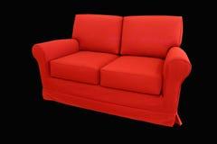Sofá rojo Fotografía de archivo libre de regalías