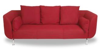 Sofá rojo Comfy del sofá aislado con el camino Imagenes de archivo