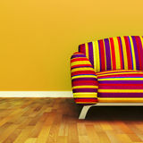 Sofa. A contemporary colorful sofa in an interior royalty free illustration