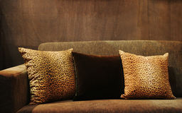 Sofa. With animal print cushions - home interiors Royalty Free Stock Images