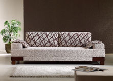 Sofa. Front view beige modern sofa Royalty Free Stock Photography