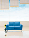 Sofa. A relaxing blue sofa in the room Stock Photography