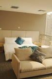 Sofa. Double bed and sofa near balcony stock photos