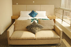 Sofa. Double bed and sofa near balcony Stock Photo