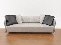 Sofa. Standing on background white wall Royalty Free Stock Photos