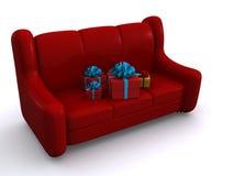 Sofa. Present boxes on sofa. 3d Royalty Free Stock Photo