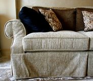 Sofa. Beige sofa in living room with brown, black Royalty Free Stock Photo