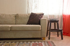 Sofa. Near the window with cushion Royalty Free Stock Images