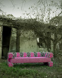 Sofa in abandoned rural place Stock Photography