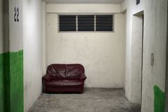 Sofa abandoned to rest while waiting for the elevator royalty free stock images