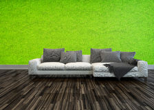 Sofa against a bright green living room wall Stock Images